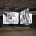 Garrett Bradley, Installation view of America, 2019. Multi-channel video installation; 35mm film transferred to video: black and white, sound, 23:55 minutes. New Orleans Museum of Art: museum purchase, Carmen Donaldson fund, 2019. Photo by Will Michels.